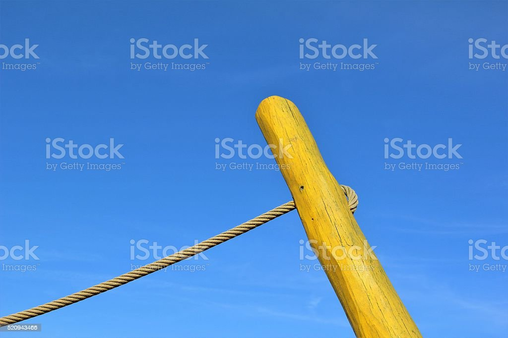 Yellow timber and rope stock photo