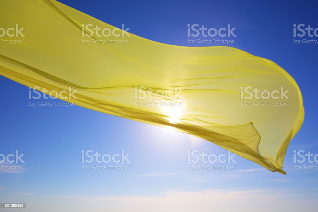 yellow tissue flying over the sea stock photo