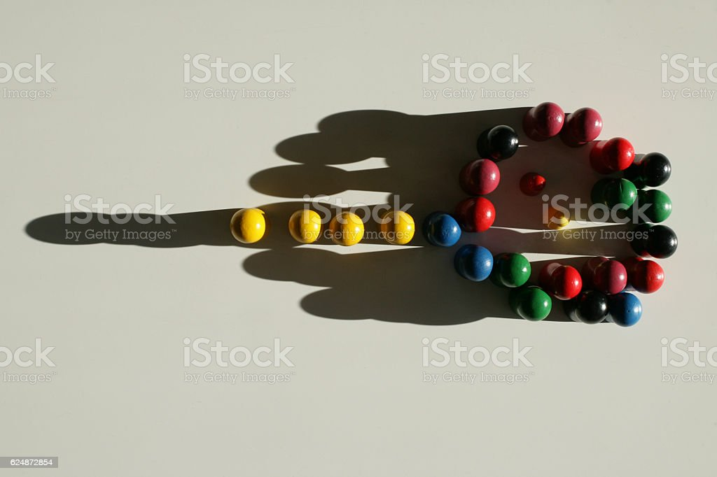 Yellow tokens in leading position stock photo