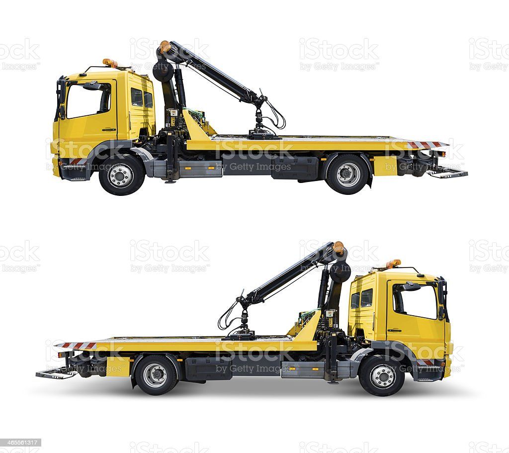 Yellow tow truck. Isolated on white with clipping path stock photo