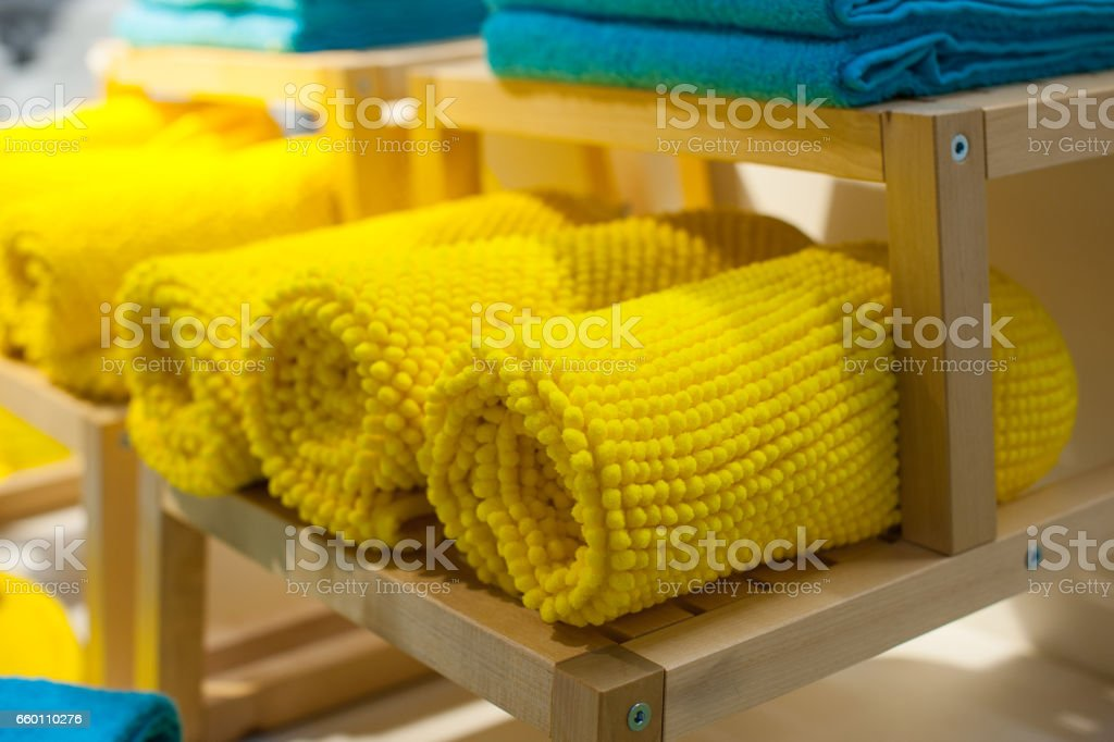 yellow towels on the shelf in the closet stock photo