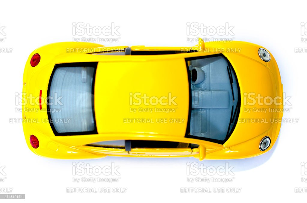 Yellow toy car from above stock photo
