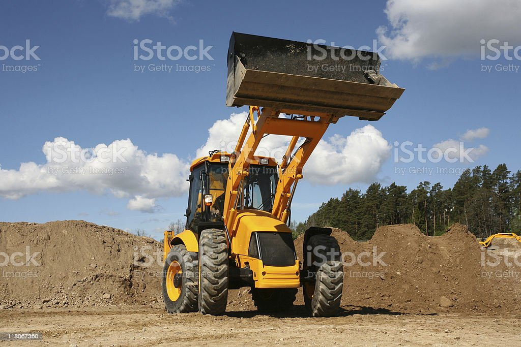 Yellow tractor working on construction site. royalty-free stock photo