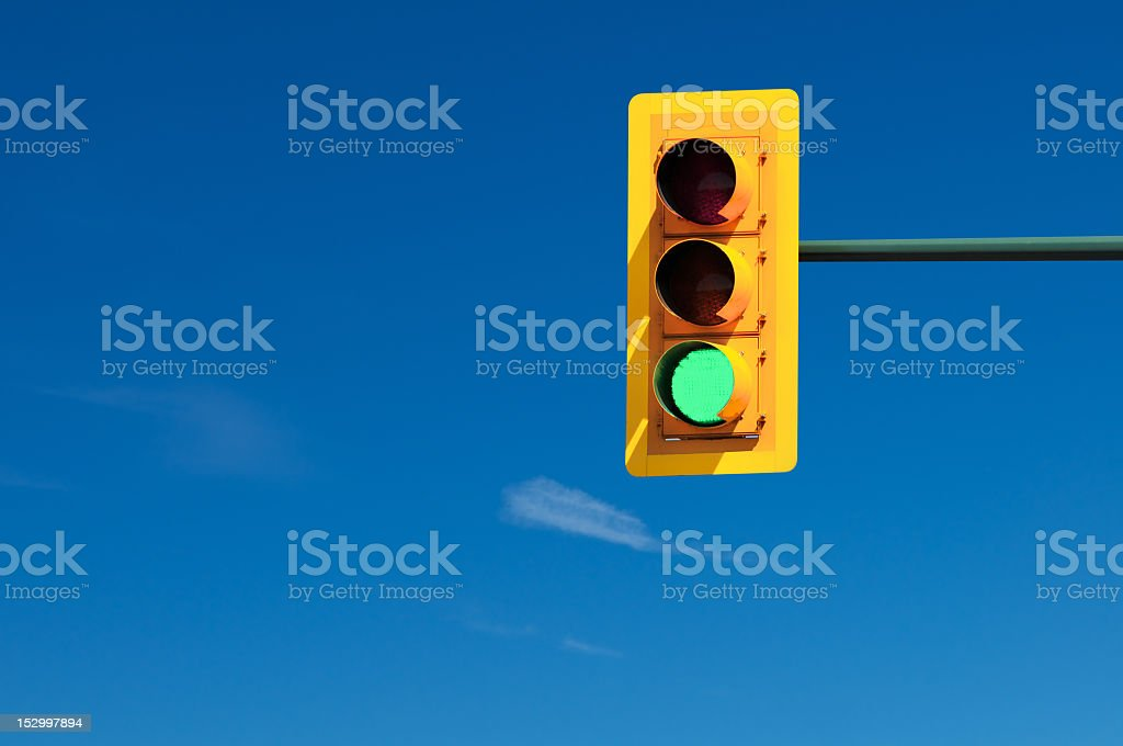 Yellow traffic light showing the green signal stock photo