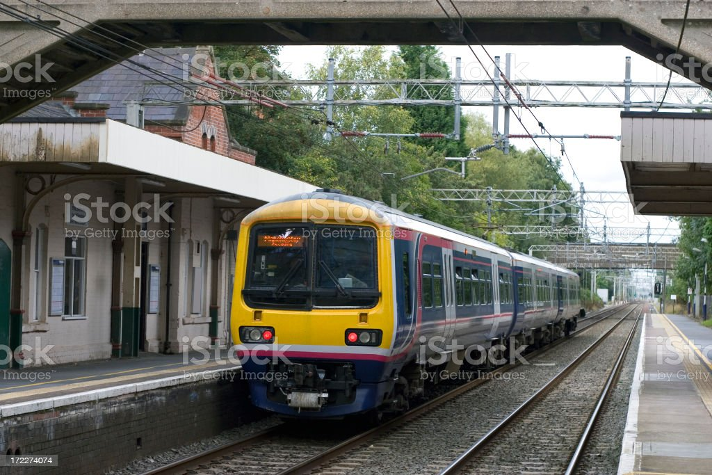 Yellow train in commuter railway station stock photo