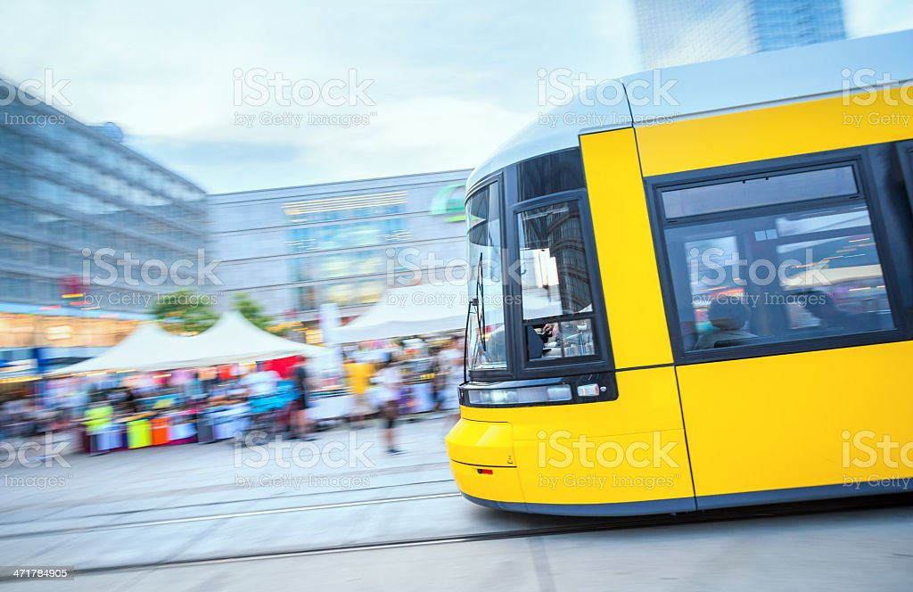 Yellow tram crossing Alexanderplatz, Berlin royalty-free stock photo