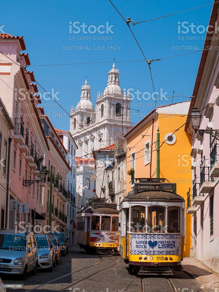 Yellow Tram in Alfama, Lisbon, Portugal stock photo