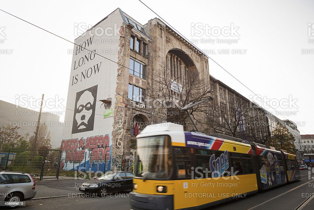Yellow Tram Pases in front of Kunsthaus Tacheles, Berlin stock photo