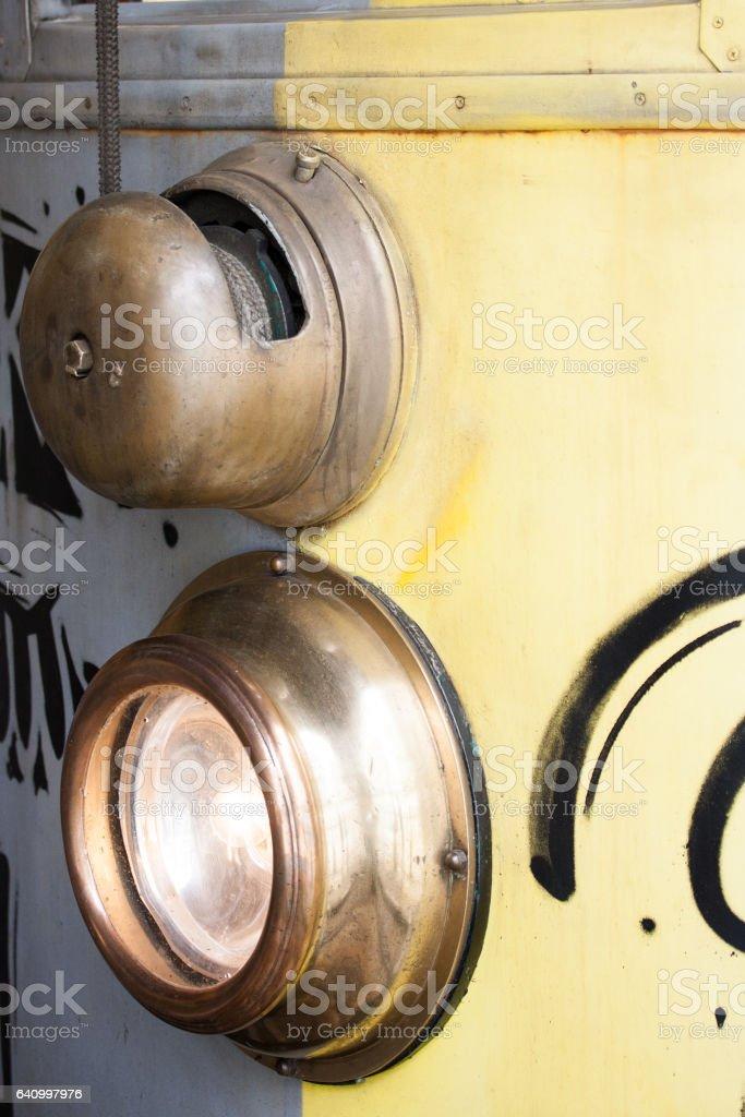 Yellow tram wagon headlight stock photo