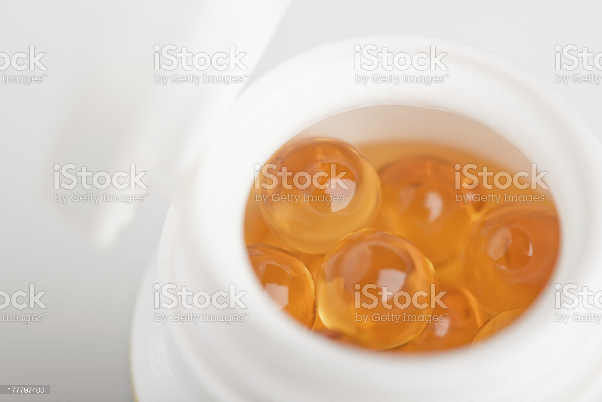 yellow transparent medicine in container royalty-free stock photo