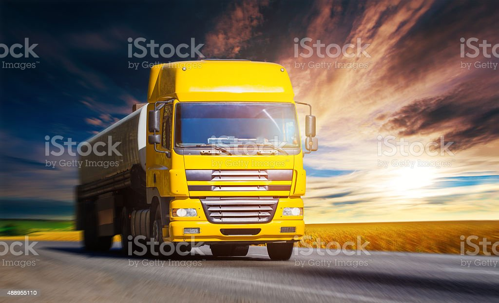 Yellow truck on highway stock photo