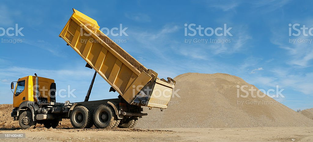 Yellow Truck Working at Construction Site royalty-free stock photo