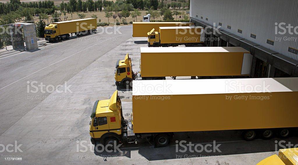 Yellow Trucks Aligned royalty-free stock photo