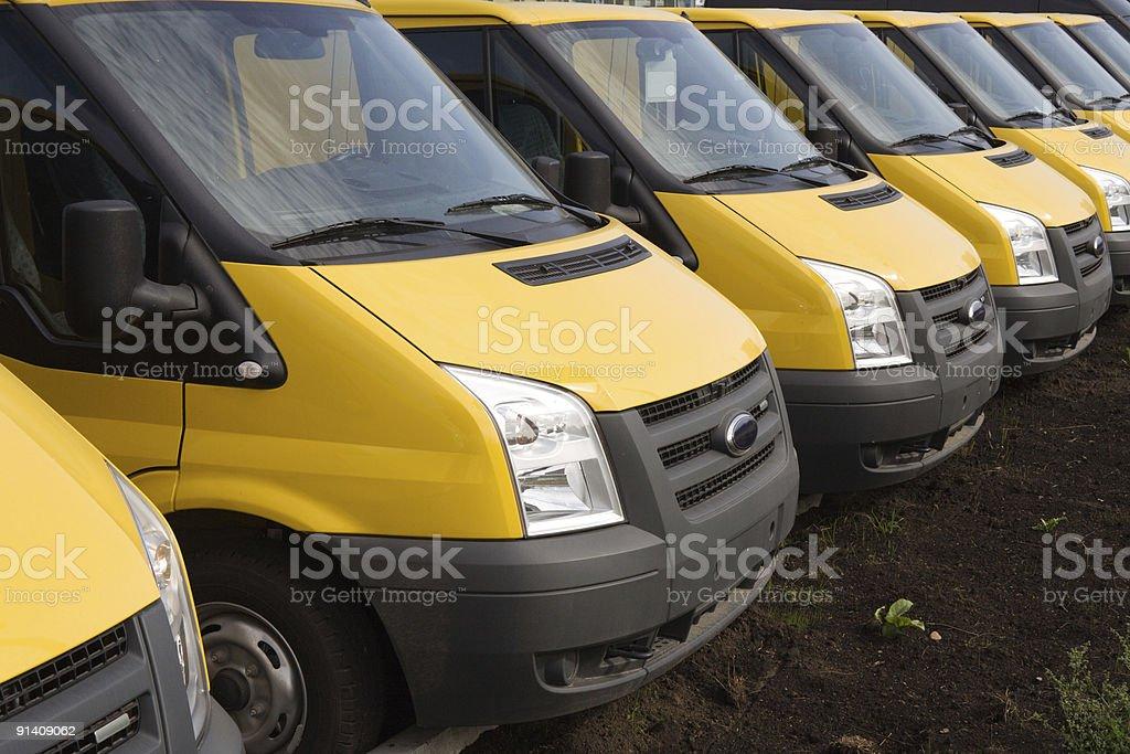 yellow trucks in a row stock photo