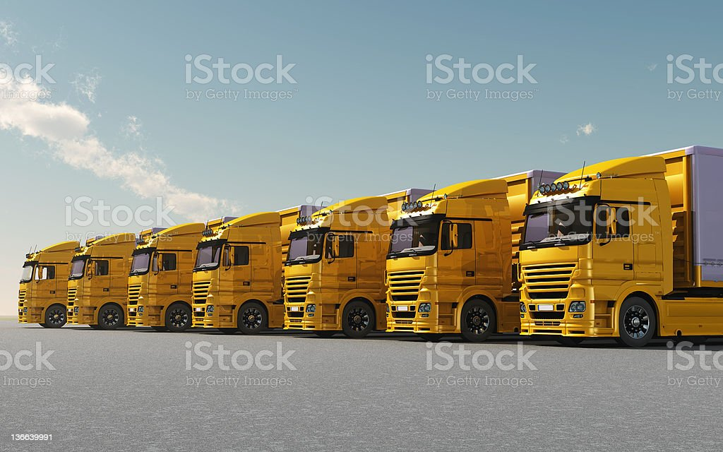 yellow trucks parked stock photo