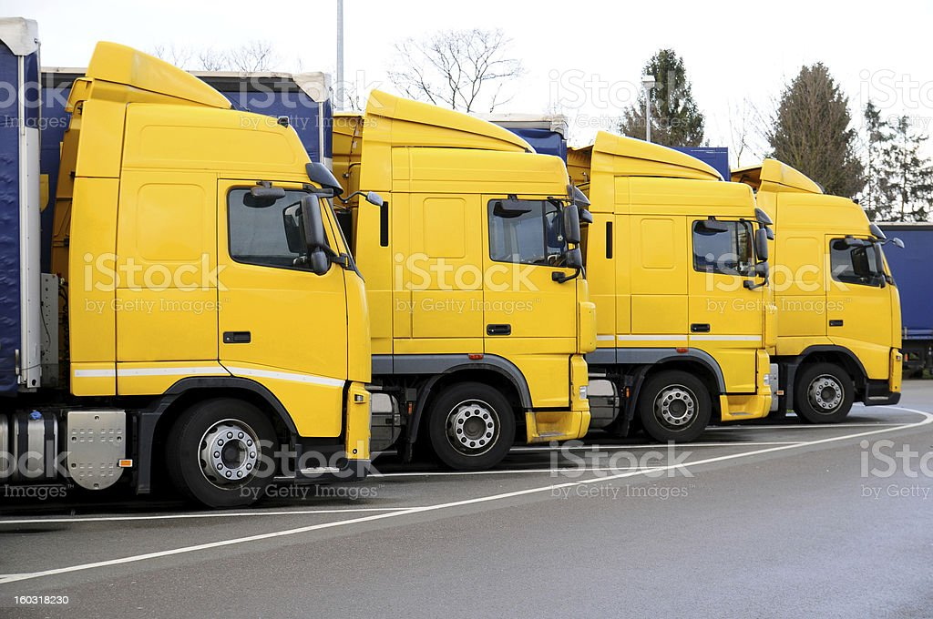 Yellow trucks parked royalty-free stock photo