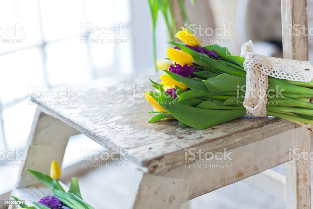 Yellow tulips and purple hyacinths flowers bouquet stock photo