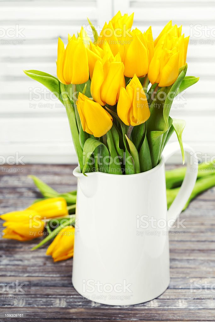 yellow tulips in a vase royalty-free stock photo
