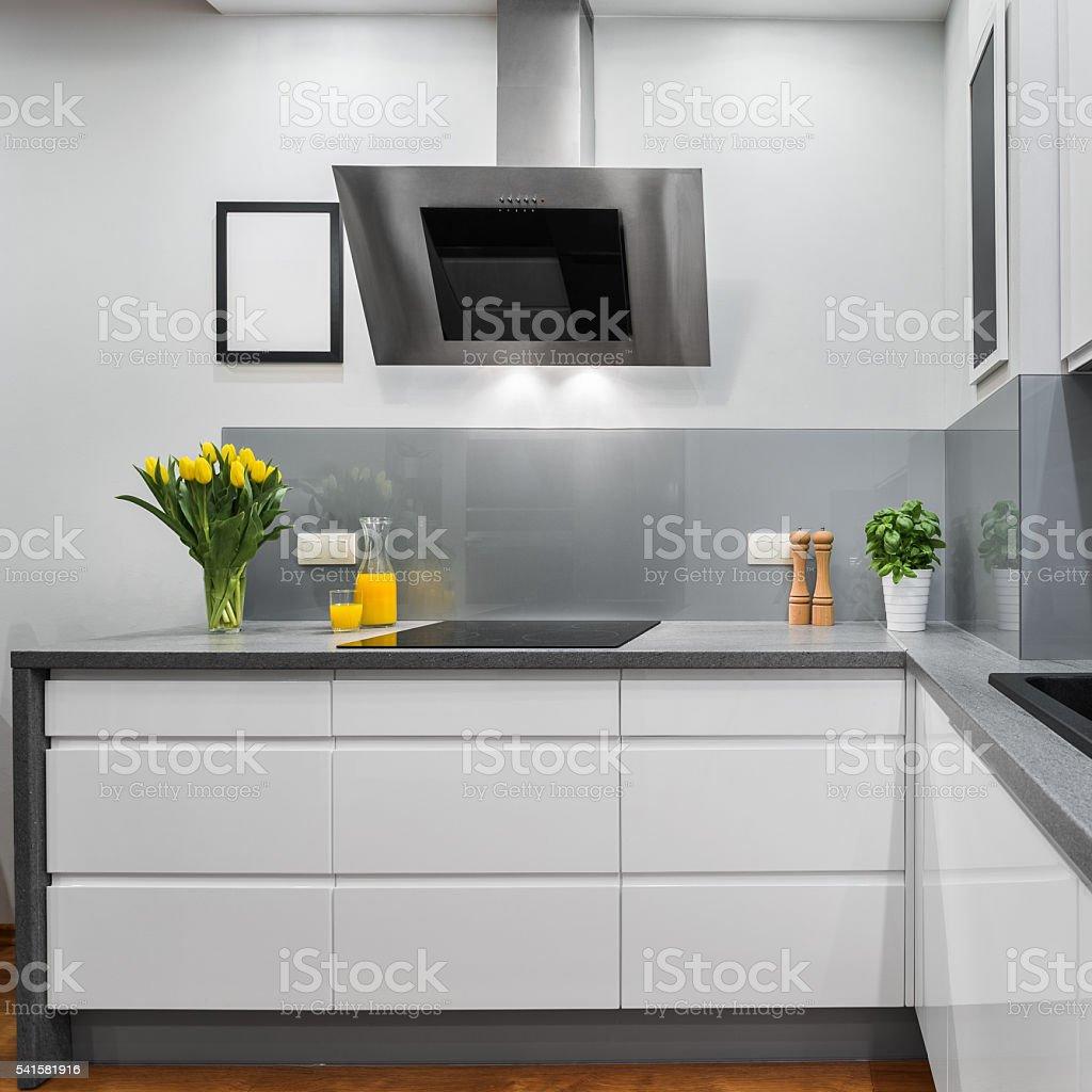 Yellow tulips in kitchen stock photo