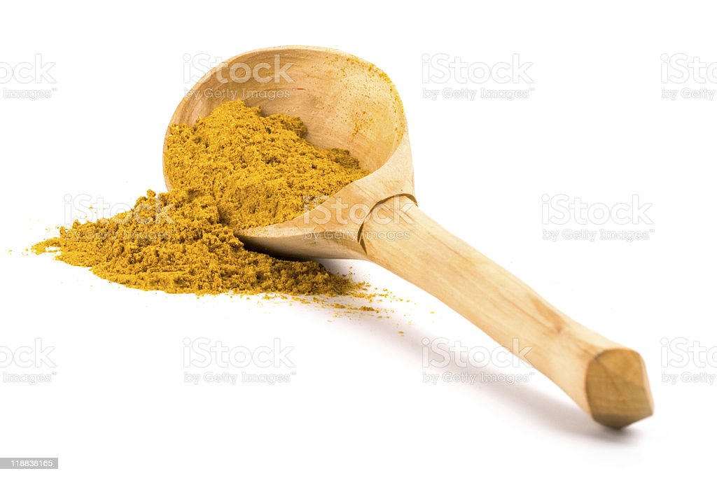 yellow turmeric in wooden spoon royalty-free stock photo