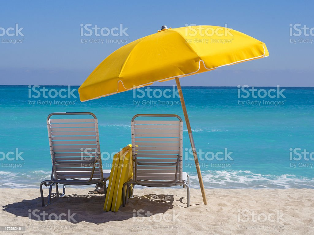 Yellow Umbrella and deck chairs South Beach Miami stock photo
