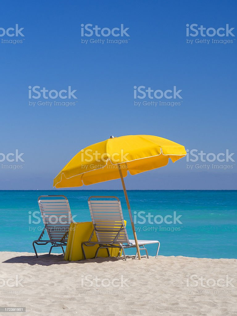 Yellow Umbrella and deck chairs South Beach Miami royalty-free stock photo