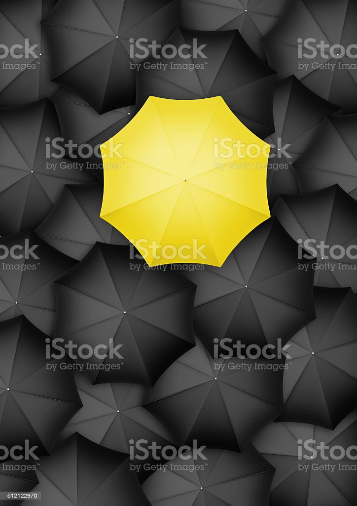 Yellow umbrella standing out from the rest stock photo