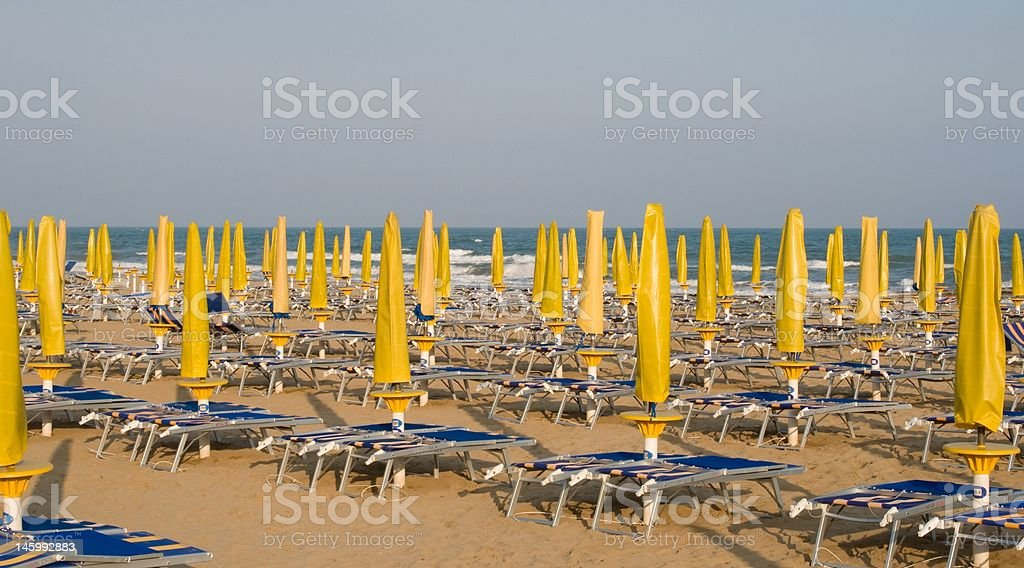 Yellow Umbrellas on a Beach in Italy royalty-free stock photo