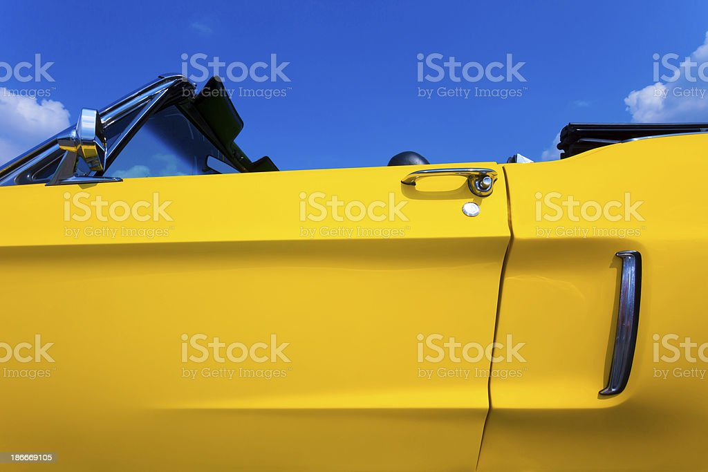Yellow Vintage American Convertible Car Against Blue Sky stock photo