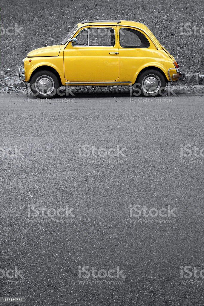 Yellow vintage car on grey,Rome Italy royalty-free stock photo