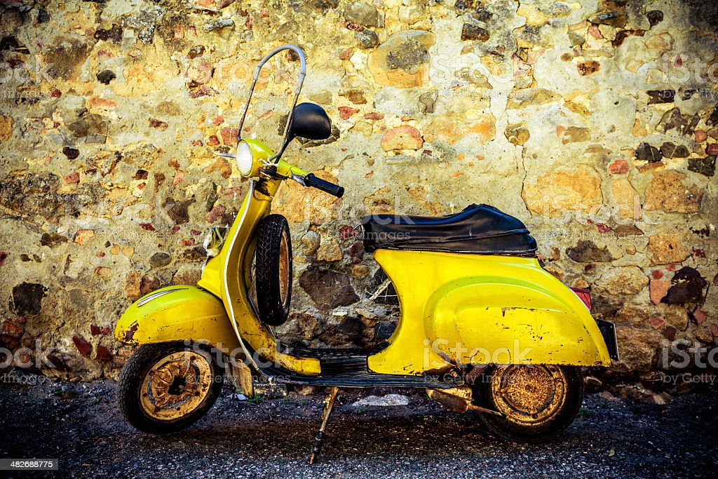Yellow Vintage Vespa Scooter in Italy royalty-free stock photo