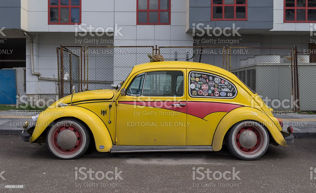 Yellow Volkswagen Beetle with Turtle Toy stock photo