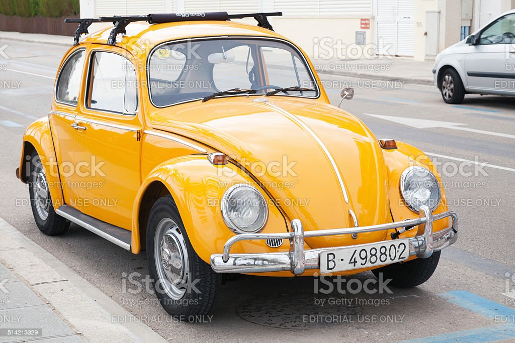 Yellow Volkswagen Kafer stands parked on the roadside stock photo