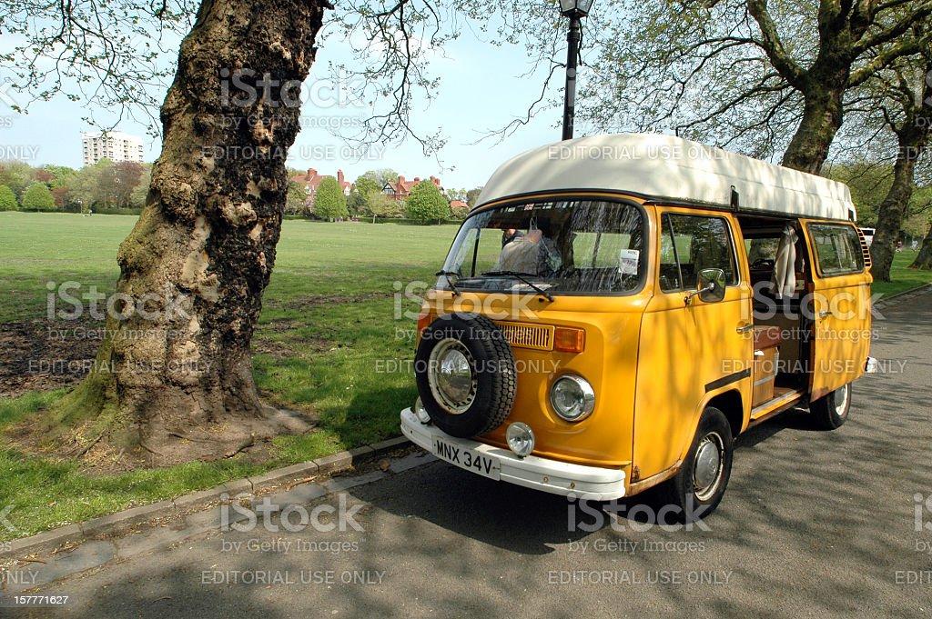 'Yellow Volkswagen Type 2 Camper Van in Sefton Park, Liverpool' stock photo