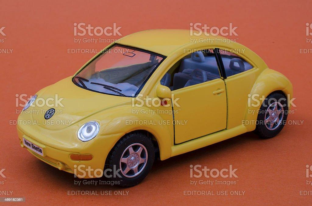 Yellow VW toy car on orange background royalty-free stock photo