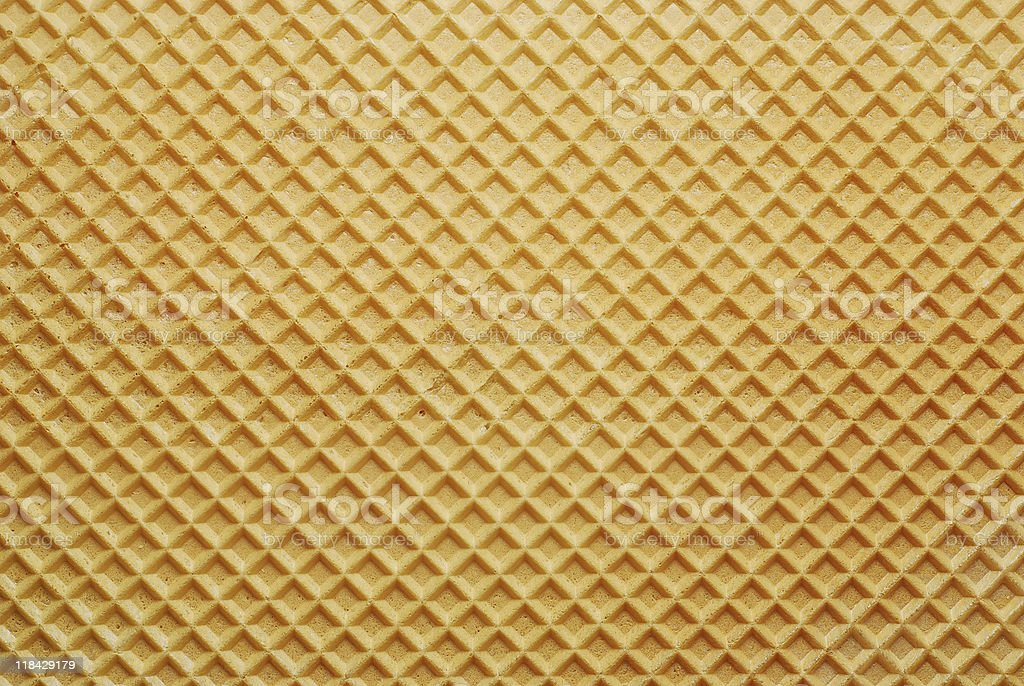 Yellow wafer background lit from above stock photo