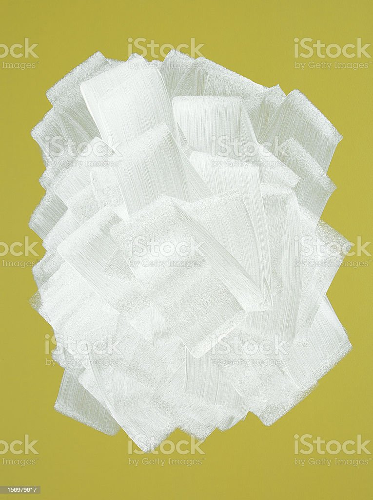 Yellow wall painted in white with paint roller royalty-free stock photo
