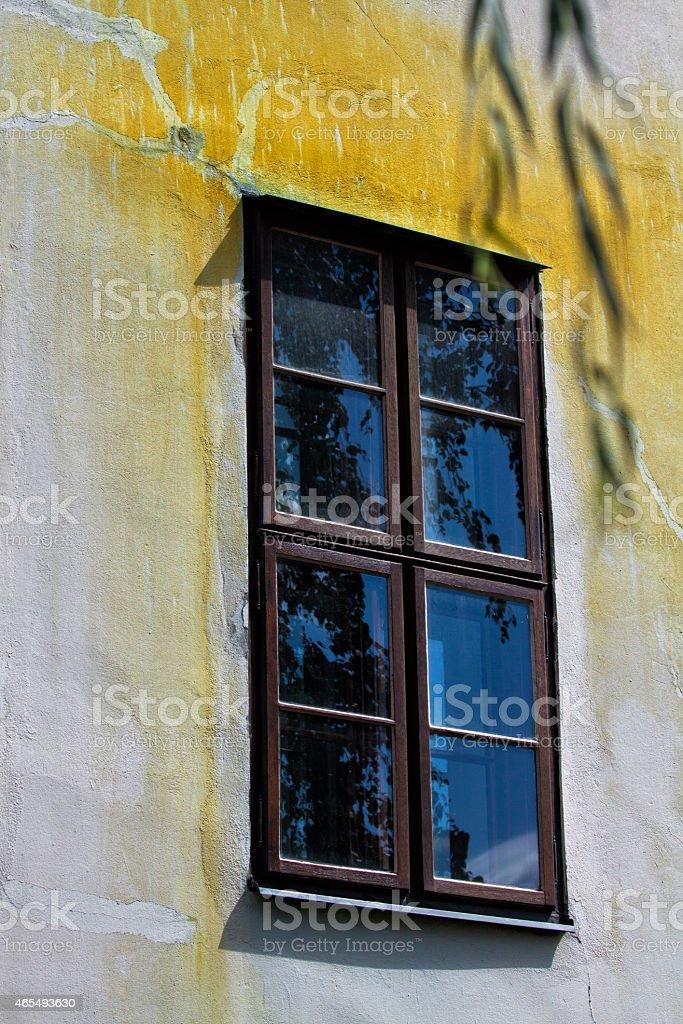 yellow wall window stock photo