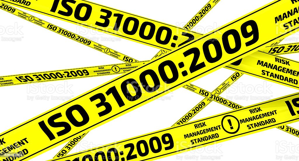 ISO 31000:2009. Yellow warning tapes stock photo