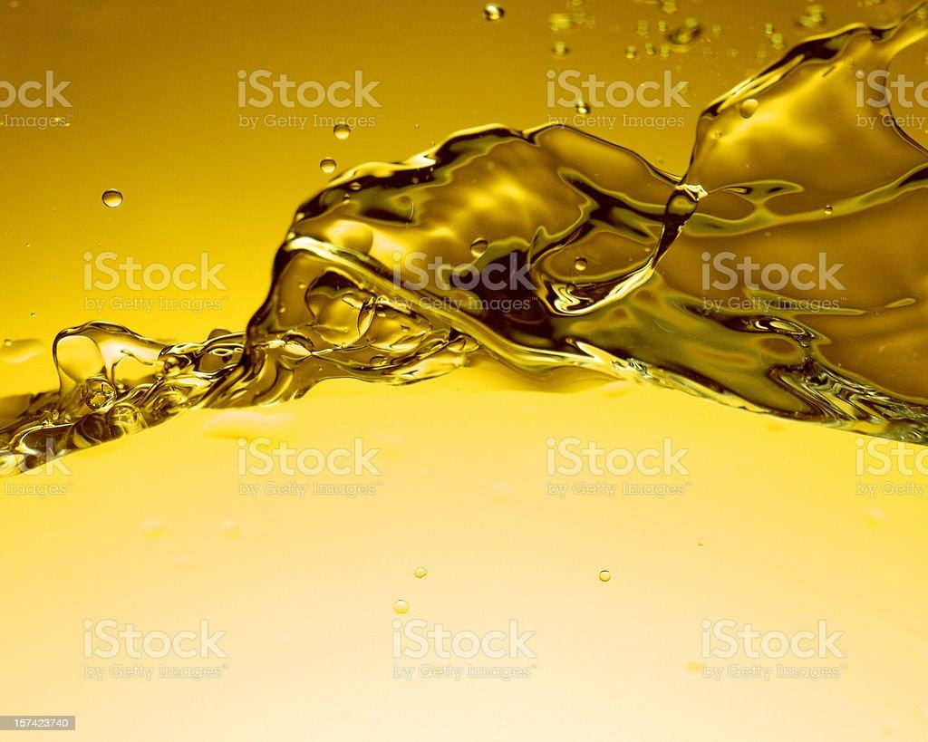 Yellow Water splashing stock photo