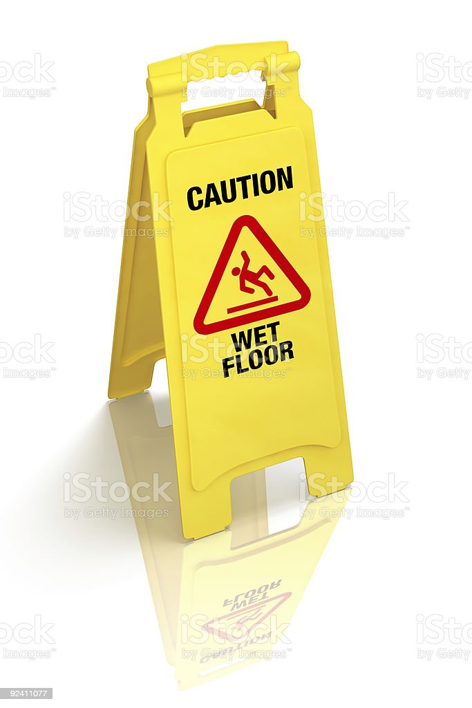 A yellow wet floor sign on a white surface stock photo