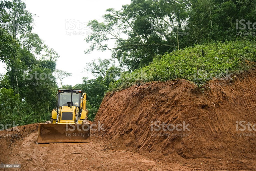Yellow wheel loader in an excavated area of ground stock photo