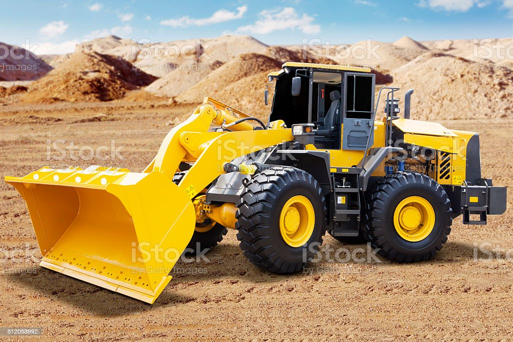 Yellow wheel loader on the mining site stock photo