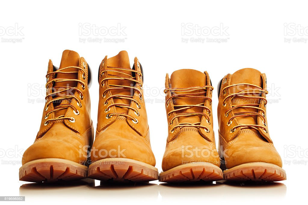 yellow winter boots on white stock photo
