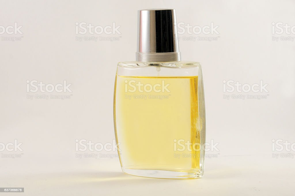 Yellow women perfume isolated on white stock photo