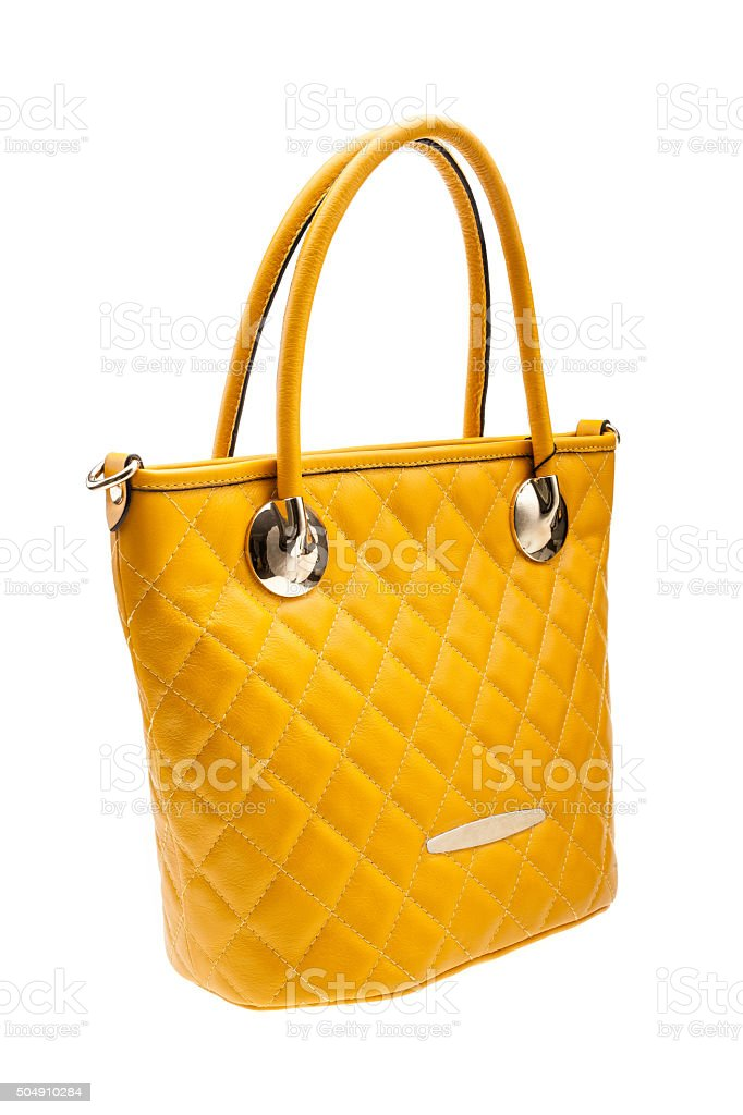 Yellow womens bag isolated on white background. stock photo