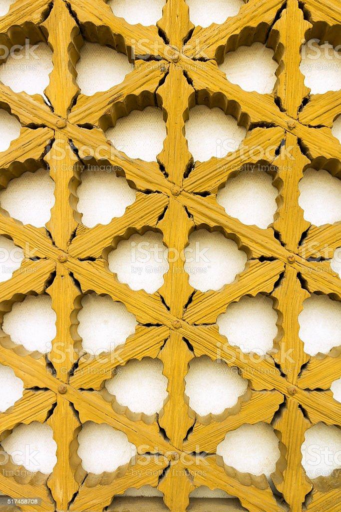Yellow wood ornament stock photo