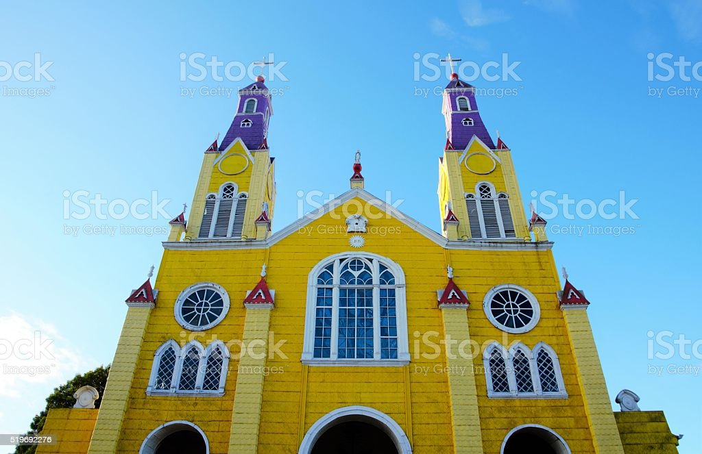 Yellow wooden church in Castro stock photo