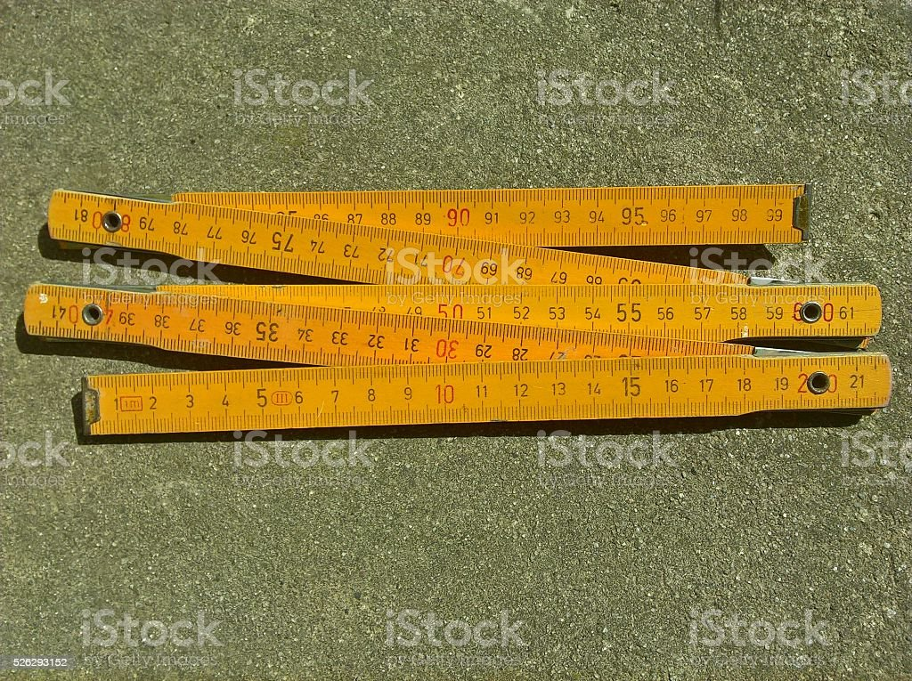 Yellow Wooden Folding Ruler stock photo