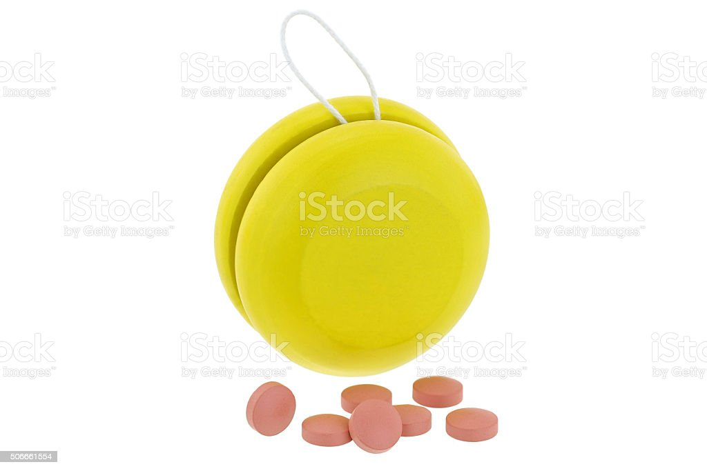 Yellow YoYo and pink medicines, ideal for Yo-Yo dieting Effect stock photo